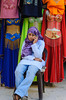 A young arab girl on her cell phone at the famous Khan El Khalili market in Cairo, Egypt.