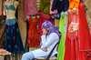 A young arab girl on her cell phone at the Khan El Khalili market in Cairo, Egypt.