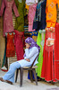 A young arab girl on her cell phone at the world famous Khan El Khalili market in Cairo, Egypt.