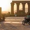 Riding Past Luxor Temple at Sunset
