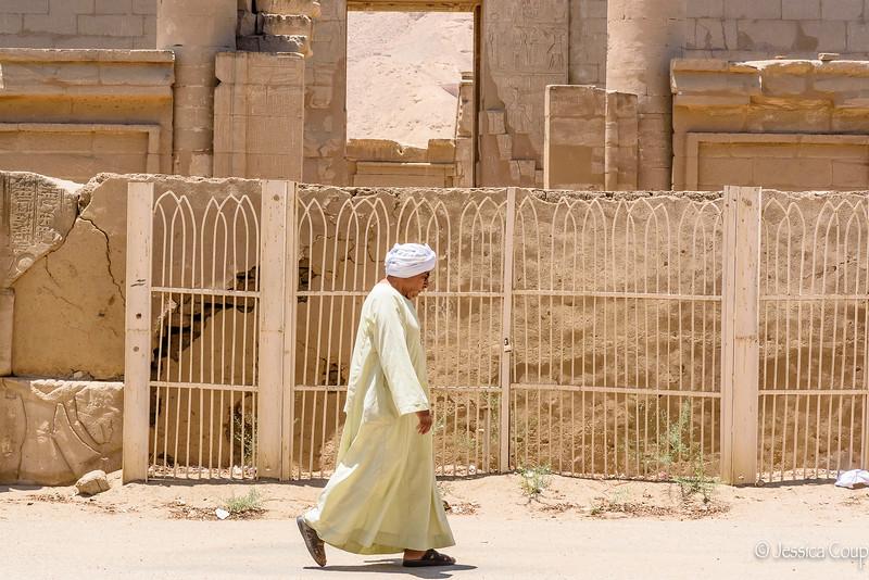 Walking Past Medinet Habu Temple