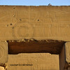 Archetrave with bullet holes and ancient defacing of hieroglyph heads in the 3000 year old Luxor Temple in Egypt