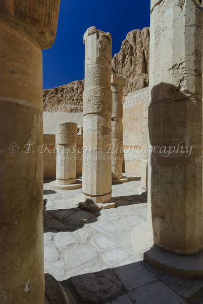 The remains of columns in Queen Hatshepsut's Temple on the west bank of the Nile River in Luxor, Egypt.
