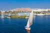 Nile River boats and a felucca sailboat on the river near Aswan, Egypt.