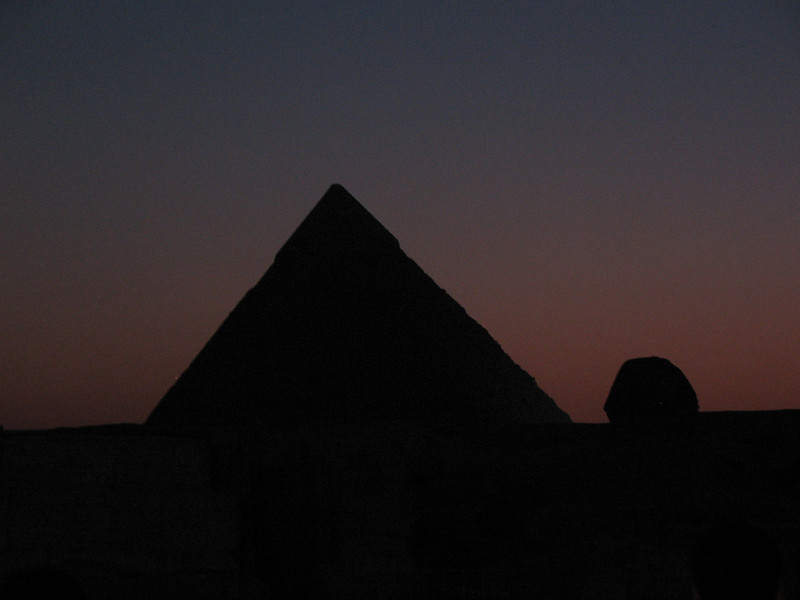 "The first night in Cairo, we were given the opportunity to see the ""Sound & Light Show"" at the Pyramids. Obviously created for tourists. <br /> <br /> After the sun set, images and holograms were projected onto the Pyramids, the Sphinx, and nearby walls to tell us the history and story of the Pyramids. It was good to just sit down, take in the air, and relax... <br /> <br /> I was thinking... ""Wow, I'm actually sitting in front of them!""<br /> <br /> I apologize for some of the shots... I haven't mastered taking shots at night on my camera yet."