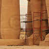 Restoration work and scaffolding at the foot of giant Osiris statues at the Ramesseum, the ancient egyptian mortuary temple of Ramses II at thebes near Luxor, Egypt