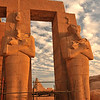 giant Osiris statues in the evening light at the Ramesseum, the ancient egyptian mortuary temple of Ramses II at thebes near Luxor, Egypt