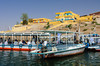 Tour boats to the Temple of Philae at the dock on lake Nasser, Egypt.