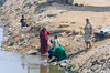 Women of the village washing their pots and pans and clothes in an irrigation ditch near Al Fayoum, Egypt.