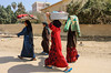 Women of the village carrying articles on their head near Al Fayoum, Egypt.