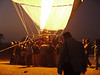Looks like the ground crew's job is to hold the basket down while the balloon is inflating.  Predawn, in an open space between the Nile River and the Valley of the Kings, West Bank, Luxor, Egypt.