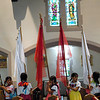 Flag bearers line themselves up for this year's annual Bienvenida celebration June 27 at Nativity of the Blessed Virgin Mary Church in Brockport.