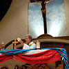 Father Jesús Flores during the Eucharistic Prayer of the annual Bienvenida Mass June 27 at Brockport's Nativity of the Blessed Virgin Mary Church.
