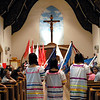 """Flag bearers enter Nativity of the Blessed Virgin Mary church during the opening song """"De Colores"""" of this year's annual Bienvenida Celebration June 27."""