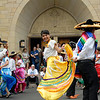"""Diana Lopez (center) performs a traditional Mexican dance with other members of the dance group """"Alma Latina"""" outside Brockport's Nativity of the Blessed Virgin Mary Church following the annual Bienvenida Mass June 27."""