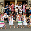 """A group of young dancers from """"Alma Latina"""" perform the """"Pineapple Dance"""" outside Brockport's Nativity of the Blessed Virgin Mary Church following the annual Bienvenida Mass June 27."""