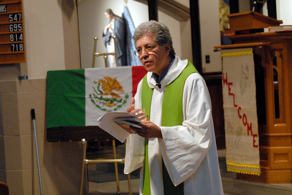 Father Jesús Flores gives the homily during the annual Bienvenida Mass June 27 at Brockport's Nativity of the Blessed Virgin Mary Church.