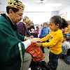 Latino Rotary Club members dress as the Three Kings and hand out gifts at the child-care center at Ibero-American Action League's Family Center on Clifford Avenue.
