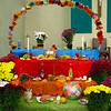 Items such as tamales, fruit and candy covered the ofrenda at St. Thomas Aquinas. An ofrenda is traditionally filled with the favorite foods and drinks of deceased loved ones to greet their visiting spirits during Day of the Dead.