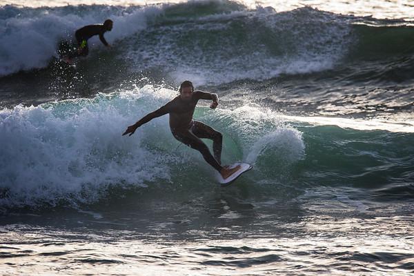 Surfers at El Porto take advantage of the winter sets., January 17, 2016
