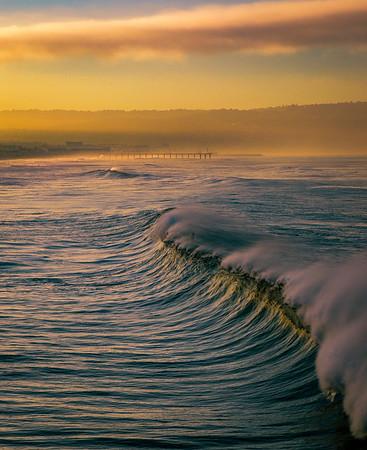 Sunrise surfer pushes through a large wave, winter 2016