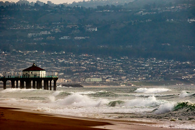 Long lens compression provides an amazing panorama of the South Bay. Manhattan Beach Pier in the foreground and Redondo Beach and Palos Verdes in the background.
