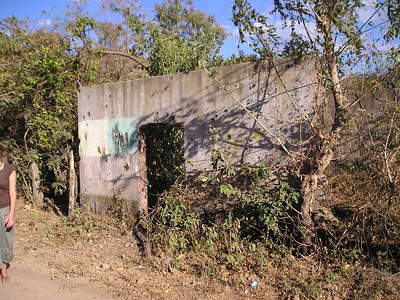 house near where Rufina Amaya hid as the sole survivor of the massacre at el Mozote, showing aircraft machine gun bullet holes