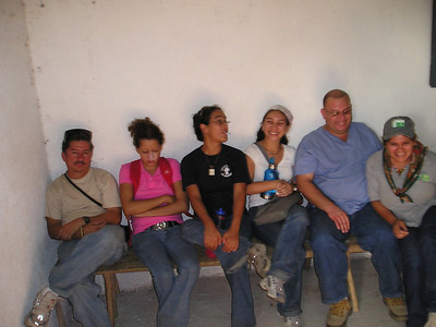 Alvaro, Milagro, Reina, Carolina, Dr. Melvin, and eyechart-pointin' health care worker
