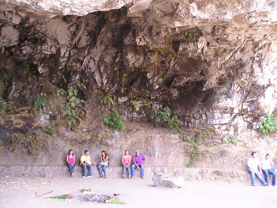 visitors under the cliff