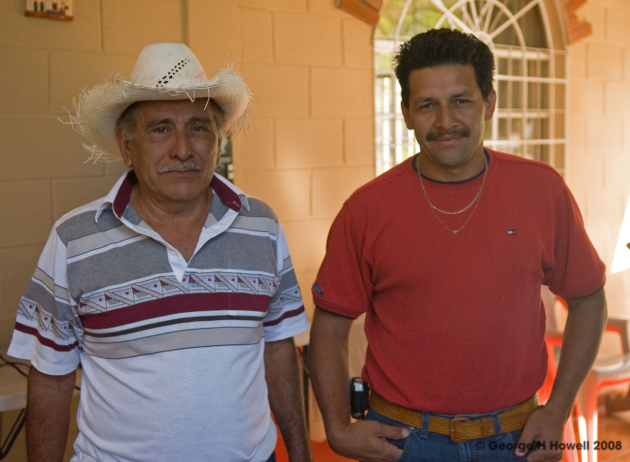 Roberto Ochoa and his son Alejandro, who supports him in his farmwork.