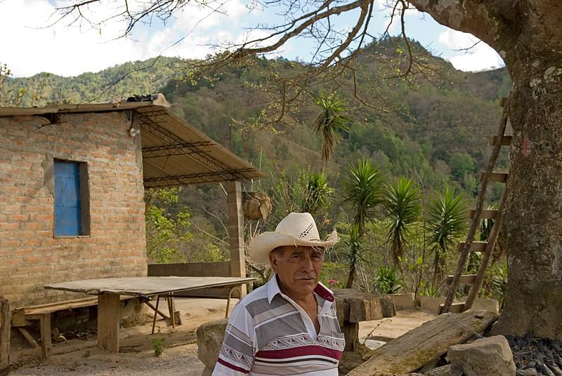 Mr. Ochoa, 61, in front of his farmhouse.