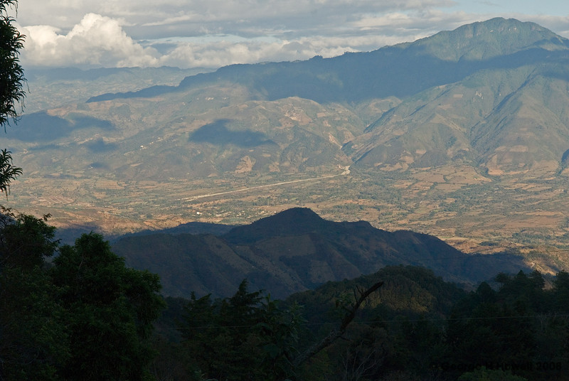 """I asked Sergio what the long white gash (in Honduras) was, down below. He replyed, """"In the year 1932, there was a terrible 'temporal'(continuoos raining of 8 days and 8 nights), and on the top of the mountain, where the river Marchala originates,  with so much rain, a kind of lagoon began to form. Then the pressure of the water was so tremendous, that the earth gave way and the water burst out and the overflooding river made the little town called Antigua Ocotepeque dissappear. Lots of people drowned, because the disaster occured at 1:00 a.m. , when most of the people were sleeping."""""""