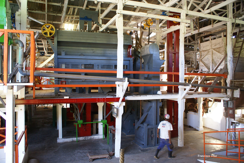 """The blue structure above is an old but very high quality coffee grader; it sorts beans by size.  To the right, also in bue, is a """"catador"""" which separates out light beans and dust before the beans go into the grader.  Photo by Francisco."""