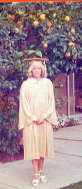 Graduation gown (& BIG LEMONS on the trees in Orange) - '75