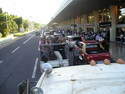 2 trucks of health care brigade arrive at El Salvador International Airport with a minute to spare.