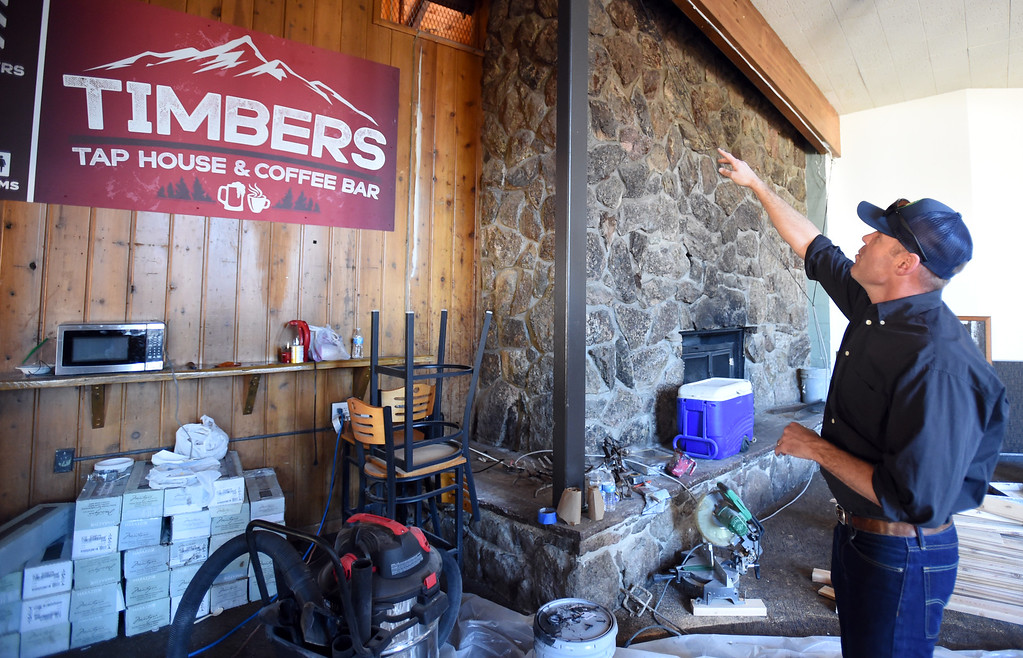 . Sam Bass points out the fireplace that was behind a wall for decades. Eldora is unveiling several new amenities (new 6-seat lift, new runs) this season, as part of a multi-million dollar project since the change in ownership. Cliff Grassmick  Staff Photographer October 12, 2017