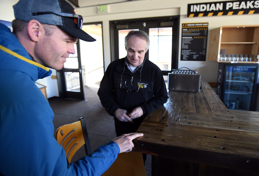 . Sam Bass, left, and Brent Tregaskis, President and General Manager of Eldora,  look at a bar made form the floor of a railroad car. Eldora is unveiling several new amenities (new 6-seat lift, new runs) this season, as part of a multi-million dollar project since the change in ownership. Cliff Grassmick  Staff Photographer October 12, 2017