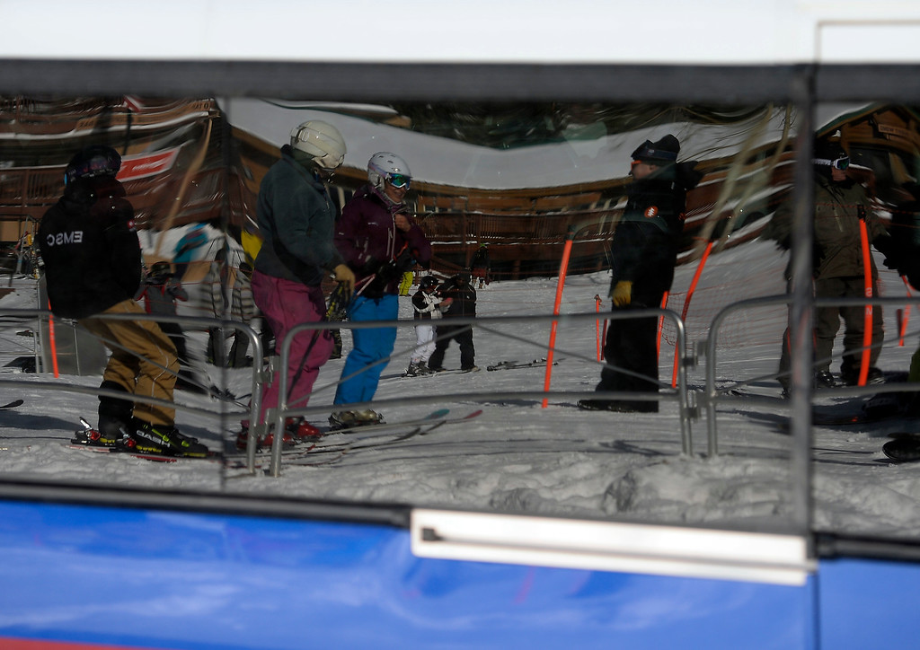 . ELDORA, CO - November 7, 2018: Skiers and boarders are reflected in the glass of an RTD bus as it drops off people. Eldora Mountain (Eldora) opened for the 2018/19 ski and snowboard season on Wednesday, November 7, 2018, a full nine days ahead of schedule.  (Photo by Cliff Grassmick/Staff Photographer)