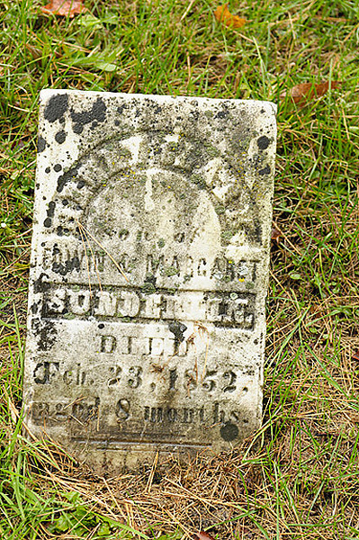 """The only """"Sunderlin"""" headstone I could identify in the entire cemetery.  Most of the burials seemed to be in family groups, and I couldn't read the names on the others in this area, but there were a lot of """"Clark"""" headstones nearby."""