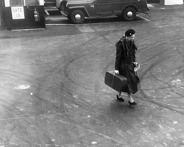 Eleanor Roosevelt carries her bags across the tarmac at New York City's LaGuardia Airport, 1960. Franklin D. Roosevelt Library Archives
