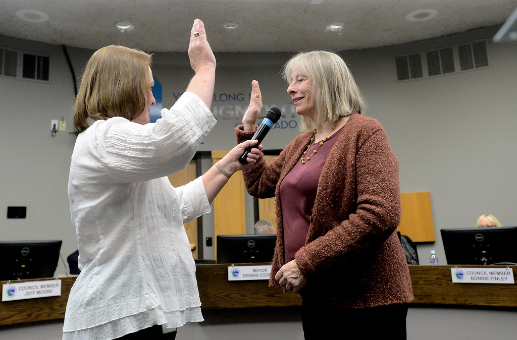 . Re-elected Longmont City Council member Polly Christensen is sworn in by City Clerk Valeria Skitt during a Longmont City Council meeting on Monday inside the City Council Chambers in Longmont. For more photos of the meeting go to timescall.com Jeremy Papasso/ Staff Photographer 11/13/2017