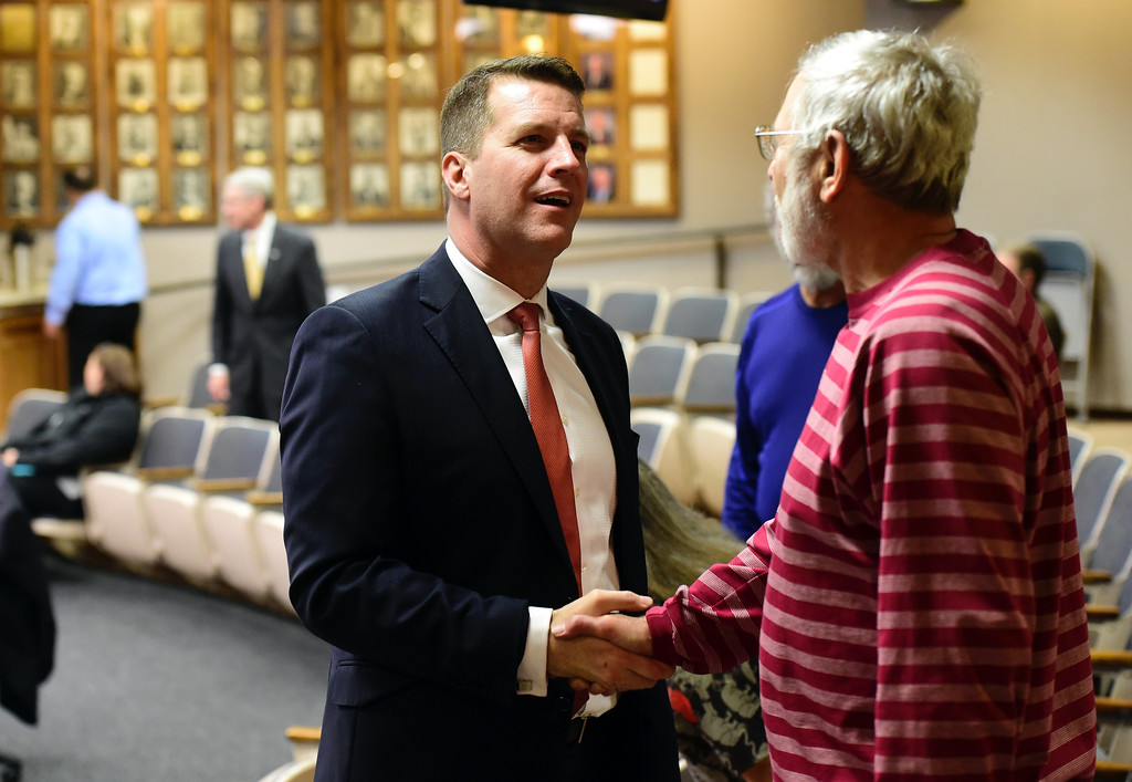 . Newly elected Mayor Brian Bagley, at left, is congratulated on his new position from former City Manager Gordon Pedrow during a Longmont City Council meeting on Monday inside the City Council Chambers in Longmont. For more photos of the meeting go to timescall.com Jeremy Papasso/ Staff Photographer 11/13/2017