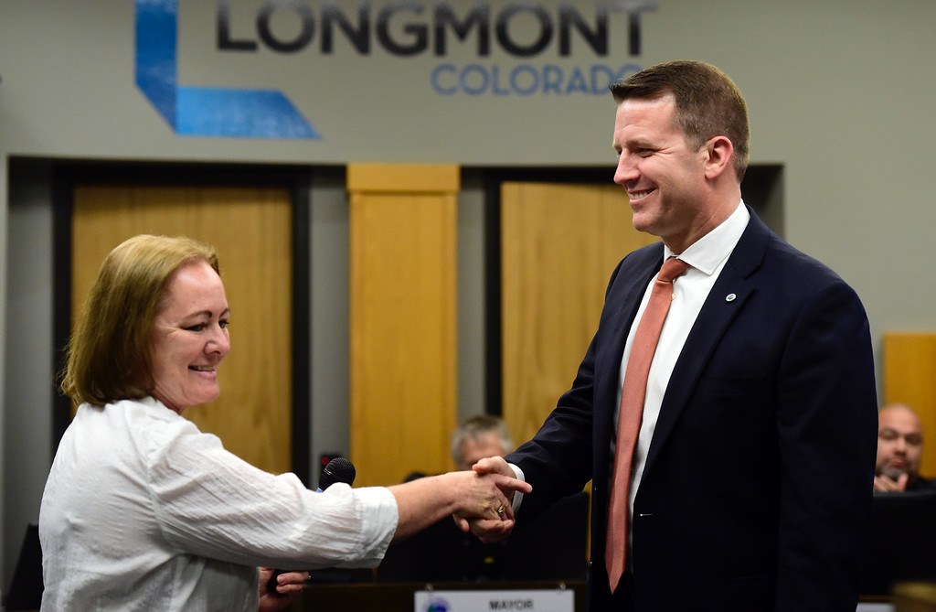 . Longmont City Clerk Valeria Skitt, left, swears in newly elected Mayor Brian Bagley during a Longmont City Council meeting on Monday inside the City Council Chambers in Longmont. For more photos of the meeting go to timescall.com Jeremy Papasso/ Staff Photographer 11/13/2017