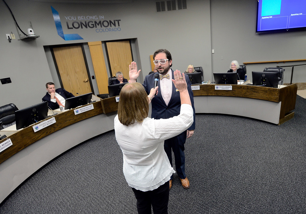 . Newly elected Longmont City Council member Aren Rodriguez is sworn in by City Clerk Valeria Skitt during a Longmont City Council meeting on Monday inside the City Council Chambers in Longmont. For more photos of the meeting go to timescall.com Jeremy Papasso/ Staff Photographer 11/13/2017
