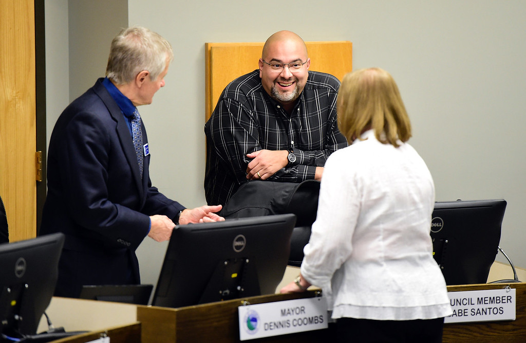 . Former Longmont Mayor Dennis Coombs, former council member Gabe Santos and City Clerk Valeria Skitt chat before a Longmont City Council meeting on Monday inside the City Council Chambers in Longmont. For more photos of the meeting go to timescall.com Jeremy Papasso/ Staff Photographer 11/13/2017