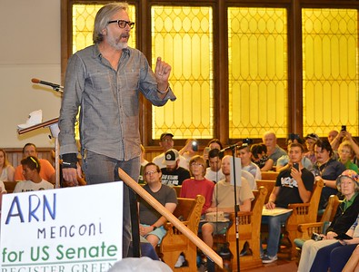 Green Party candidate for US Senate seat in Colorado, Arn Menconi, speaks at a campaign rally in Colorado Springs.