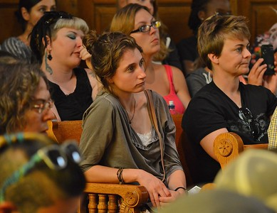 Young woman listens intently at speech by Jill Stein, Green party candidate for President.