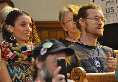 Supporters of Green Party Presidential candidate Jill Stein listen to her speak at a rally.