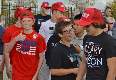 "Young boys wearing Donald Trump hats and shirts. One gives the ""thumbs up"" another wears a ""Hillary For Prison"" shirt."