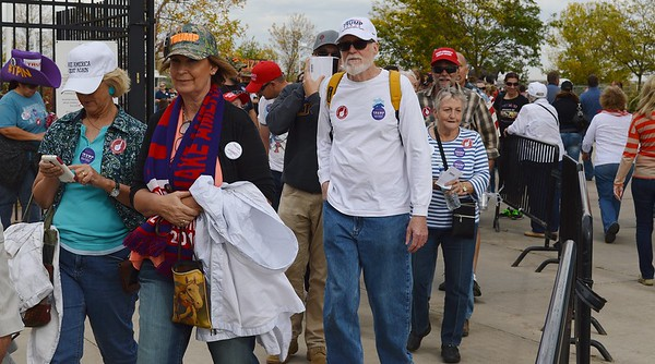 Donald Trump supporters wearing campaign hats, shirts and buttons, in line for a Donald Trump rally.